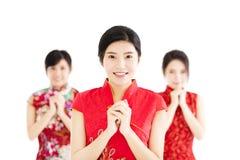 Año Nuevo chino feliz Mujer con gesto de la enhorabuena Foto de archivo
