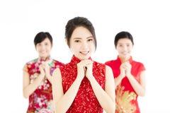 Año Nuevo chino feliz Mujer con gesto de la enhorabuena Imagen de archivo