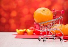 Año Nuevo chino, naranja que hace compras Fotografía de archivo libre de regalías