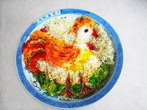 Año Nuevo chino Yusheng - gallo Imagenes de archivo