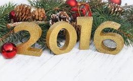 Año Nuevo 2016 con el ornamento de la Navidad Foto de archivo libre de regalías