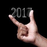 Año Nuevo 2017 con la mano Imágenes de archivo libres de regalías