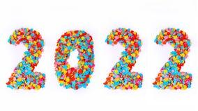 Año Nuevo - confeti numera 2022 - aislado en el fondo blanco Foto de archivo libre de regalías