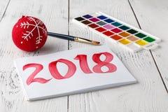 Año Nuevo de dibujo 2018 con el cepillo de pintura Imágenes de archivo libres de regalías