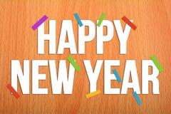 Año Nuevo de Hapy en fondo de madera con los papeles coloridos Foto de archivo libre de regalías