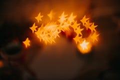 Año Nuevo del bokeh rojo de oro y decoraciones de la Navidad, defocused Foto de archivo libre de regalías