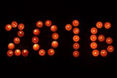 Año Nuevo 2016 del fondo de la oscuridad de las velas Imagen de archivo libre de regalías