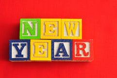 Año Nuevo deletreado con los bloques del alfabeto Imagen de archivo