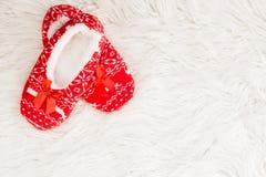 Año Nuevo, deslizadores de la Navidad en la piel suave blanca Divertido, divertido, acogedor Fotografía de archivo libre de regalías