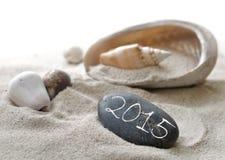 Año Nuevo 2015 en el guijarro Imagen de archivo libre de regalías