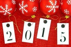 Año Nuevo 2015 en etiquetas y bolas de la Navidad Imagen de archivo
