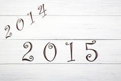 Año Nuevo 2015, en un fondo de madera Imagen de archivo libre de regalías