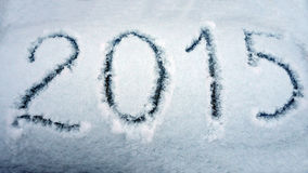 Año Nuevo 2015 a escribir en la nieve Imágenes de archivo libres de regalías