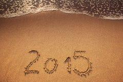 Año Nuevo 2015 escrito en arena Imágenes de archivo libres de regalías