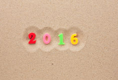 Año Nuevo 2016 escrito en la arena Imagen de archivo