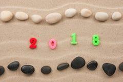 Año Nuevo 2018 escrito en la arena, con el espacio para su texto Fotos de archivo libres de regalías