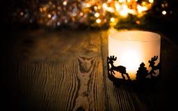 Año Nuevo, fondo de la Navidad con la vela de la Navidad Imagen de archivo libre de regalías