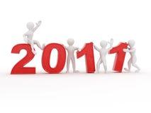 Año Nuevo. Hombres con los números 2011 Imagen de archivo