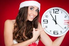 Año Nuevo, muchacha de santa, reloj, tiempo Imagenes de archivo