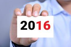 Año Nuevo número 2016 en tarjeta de visita Foto de archivo libre de regalías