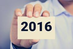 Año Nuevo número 2016 en tarjeta de visita Imágenes de archivo libres de regalías