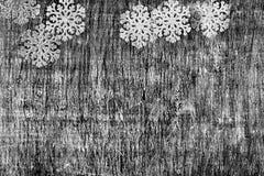 Año Nuevo y fondo blanco y negro de la Navidad de una madera Foto de archivo