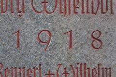 Año 1918 tallado en piedra Imagenes de archivo