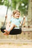 3 años de bebé en el oscilación Imagen de archivo libre de regalías