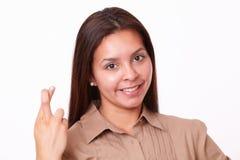 20-24 años de muchacha hispánica con la muestra de la suerte Fotografía de archivo libre de regalías