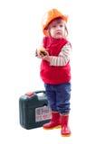 2 años de niño en el casco de protección con las herramientas Imagen de archivo libre de regalías