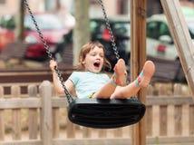 3 años de niño en el oscilación Foto de archivo libre de regalías