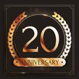 20 años del aniversario de bandera del oro en fondo oscuro Foto de archivo libre de regalías