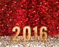 2016 años en rojo y fondo del brillo del oro, concepto del día de fiesta Imagen de archivo