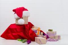Años Nuevos de bolso rojo del concepto con las decoraciones para el día de fiesta Fotografía de archivo libre de regalías