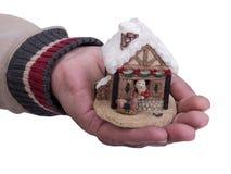 Años Nuevos de casa en la mano Foto de archivo libre de regalías