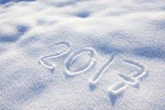 Años Nuevos de fecha 2017 escrita en nieve Imágenes de archivo libres de regalías
