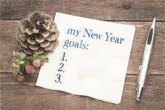 Años Nuevos de lista de las metas en servilleta Fotografía de archivo