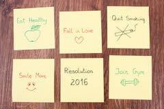 Años Nuevos de resoluciones en la hoja de papel amarilla Foto de archivo