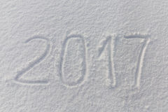 2016 Años Nuevos escritos en el fondo blanco de la nieve Fotografía de archivo libre de regalías