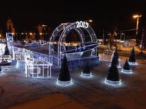 2015 Años Nuevos feliz, Feliz Navidad en pista de patinaje del invierno Imagen de archivo