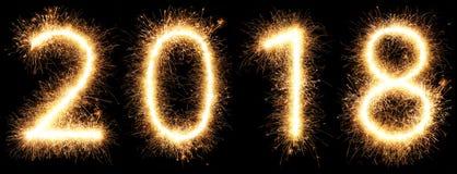 Años Nuevos que brillan intensamente brillantes 2018 de la bengala del fuego artificial aislados Imagen de archivo libre de regalías