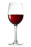 Aún-vida con el vidrio de vino rojo en un blanco Imágenes de archivo libres de regalías
