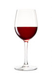 Aún-vida con el vidrio de vino rojo en un blanco Foto de archivo libre de regalías