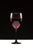 Aún-vida con la copa de vino en negro Foto de archivo