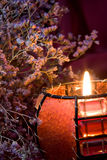 Aún-vida con la vela ardiente Foto de archivo libre de regalías
