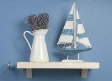 Aún-vida con lavanda y el barco de vela Imágenes de archivo libres de regalías