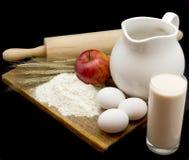 Aún-vida con leche y huevos Imagen de archivo libre de regalías