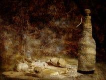 Aún-vida con tocino, pan y vodka Imagen de archivo libre de regalías