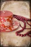 Aún-vida con una vela roja y granos Fotografía de archivo libre de regalías