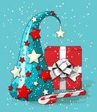 Aún-vida de la Navidad, árbol abstracto azul con la caja de regalo roja y bastón de caramelo en el fondo azul, ejemplo Foto de archivo libre de regalías